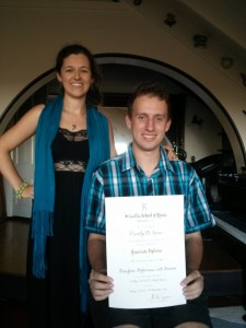 Tim Di Ienno, student of 8 years receives his associate diploma